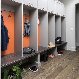 Trendy dark wood floor mudroom photo in Detroit with gray walls