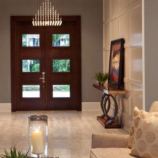Cette photo montre une entrée tendance avec une porte en bois foncé, une porte double, un sol en marbre et un sol beige.
