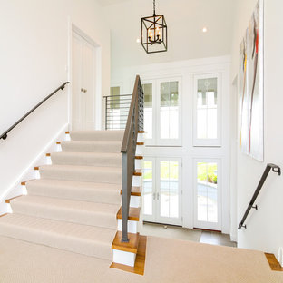 Coastal double front door photo in New York with white walls and a glass front door