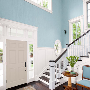 Inspiration for a large transitional dark wood floor entryway remodel in Charlotte with blue walls and a gray front door