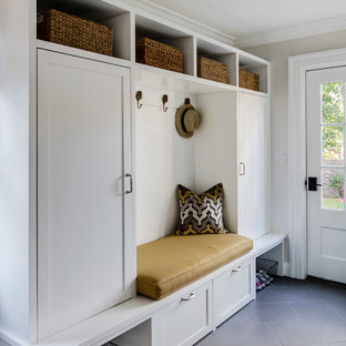 Inspiration for a transitional gray floor entryway remodel in Boston with beige walls and a white front door