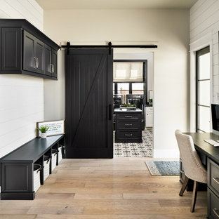 Entryway - transitional light wood floor and beige floor entryway idea in Other with white walls and a glass front door