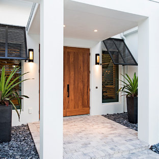 Design ideas for a large world-inspired front door in San Francisco with white walls, slate flooring, a medium wood front door, white floors and a double front door.