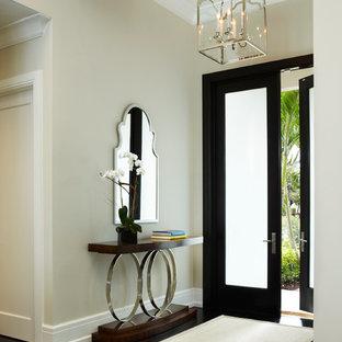 Entryway - transitional entryway idea in Miami with beige walls