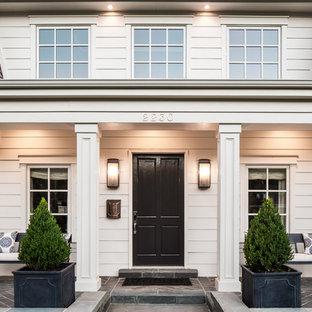 ソルトレイクシティの片開きドアトラディショナルスタイルのおしゃれな玄関ドア (黒いドア) の写真