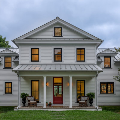 Inspiration for a cottage entryway remodel in New York with a red front door
