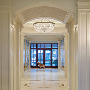 Example of a classic entryway design in Toronto with beige walls and a glass front door