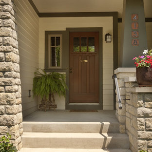 Arts And Crafts Entryway Photo In Columbus With A Dark Wood Front Door