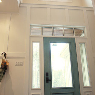 Entryway - mid-sized traditional ceramic floor entryway idea in Ottawa with white walls and a glass front door