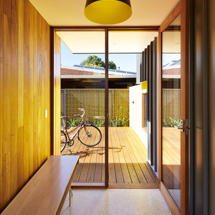 Inspiration for a contemporary mudroom in Adelaide with brown walls, a single front door and beige floor.