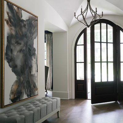 Inspiration for a mid-sized transitional dark wood floor and brown floor entryway remodel in Atlanta with white walls and a dark wood front door