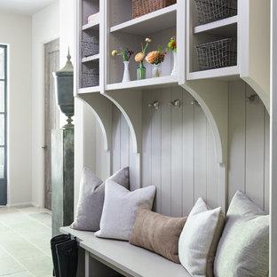 На фото: тамбуры среднего размера в стиле современная классика с серыми стенами, полом из известняка и серым полом