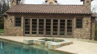 Custom cedar 21' bifolding entry on a pool house