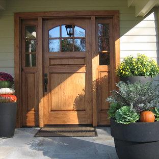 Single front door - traditional single front door idea in Philadelphia with a medium wood front door