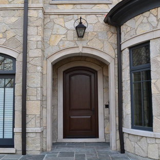 Inspiration for a mid-sized victorian entryway remodel in Chicago with a dark wood front door
