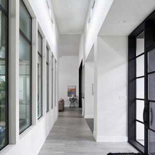 Inspiration för en vintage foajé, med vita väggar, klinkergolv i porslin, en enkeldörr, glasdörr och grått golv