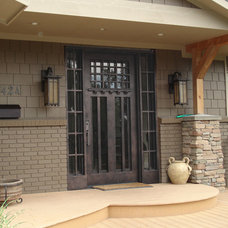 Traditional Front Doors by Visionmakers Custom Stone & Iron Doors