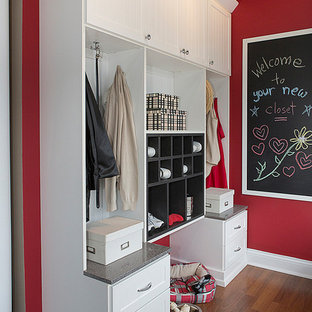 Mudroom - transitional dark wood floor and brown floor mudroom idea in Raleigh with red walls