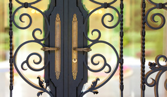 Custom ornate wrought iron / glass front entry door 24k gold plated handles.