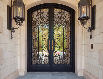 Custom ornate wrought iron / glass front entry door / Gas Lanterns.