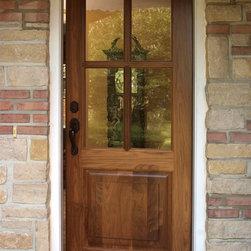 Custom Walnut Exterior Door - Custom walnut 4 lite/single raised panel exterior entry door.