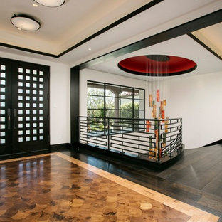 Inspiration for a bamboo floor double front door remodel in Orange County with white walls and a black front door