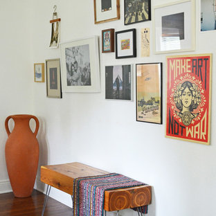 Example of an eclectic dark wood floor entryway design in Dallas with white walls