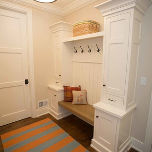 Mid-sized transitional dark wood floor entryway photo in San Diego with beige walls and a white front door