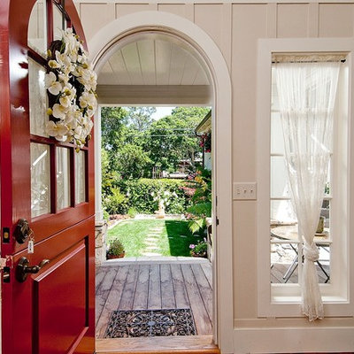 Inspiration for a mid-sized timeless light wood floor entryway remodel in Seattle with beige walls and a red front door