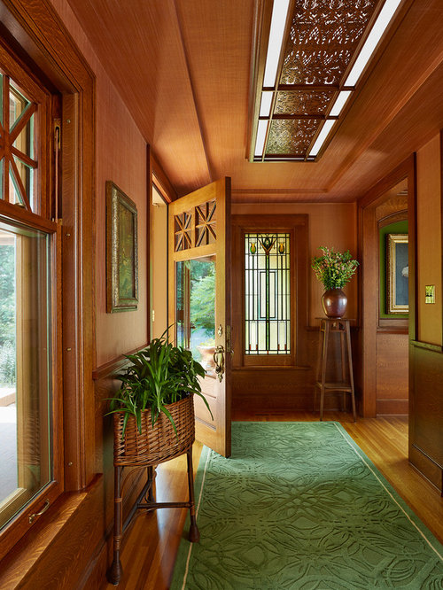 Example Of An Arts And Crafts Foyer Design In Minneapolis With Medium Tone  Hardwood Floors,
