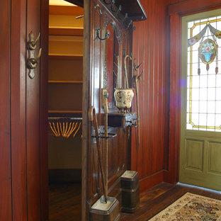 Entryway - huge rustic dark wood floor entryway idea in Salt Lake City with red walls and a green front door