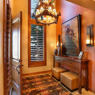 This is an example of a mid-sized foyer in Salt Lake City with yellow walls, travertine floors, a single front door and a medium wood front door.