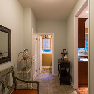 Example of a small transitional linoleum floor entryway design in New York with blue walls and a red front door