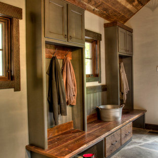 Inspiration for a rustic mudroom remodel in Minneapolis with beige walls