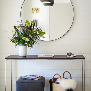 Inspiration for a small 1950s ceramic floor entryway remodel in San Francisco with white walls