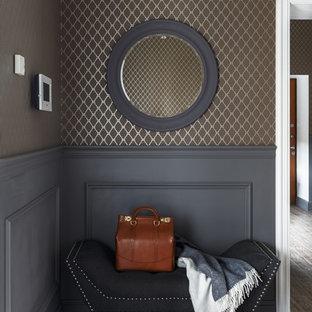 На фото: прихожие в стиле современная классика с коричневыми стенами и коричневым полом