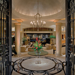 Example of a large tuscan entryway design in Los Angeles
