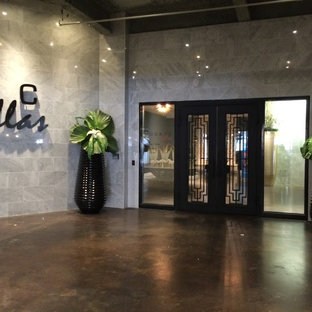 Gentil Foyer   Large Contemporary Concrete Floor Foyer Idea In Dallas With Gray  Walls. Save Photo. Downtown Apartment Lobby. By Lawanna Wood Designs