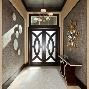 Example of a mid-sized trendy marble floor and beige floor entryway design in Other with a dark wood front door and metallic walls