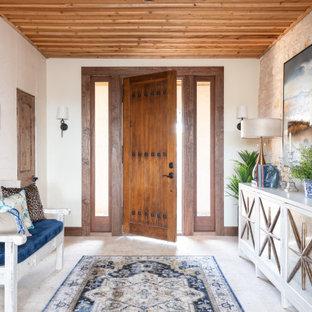 Foto de distribuidor madera, de estilo americano, con paredes blancas, puerta simple, puerta de madera en tonos medios y suelo beige