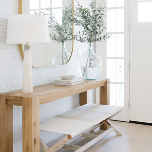 Inspiration for a beach style light wood floor and beige floor single front door remodel in San Francisco with white walls and a white front door