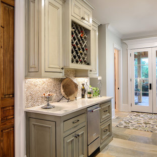 Inspiration for a large timeless travertine floor and beige floor entryway remodel in New Orleans with gray walls and a white front door