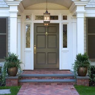 Cette photo montre une porte d'entrée chic avec une porte simple.