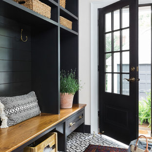 Inspiration for a mid-sized cottage ceramic tile mudroom remodel in Boston with white walls and a black front door