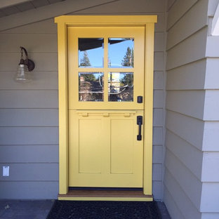 Inspiration for a small transitional slate floor entryway remodel in San Francisco with gray walls and a yellow front door