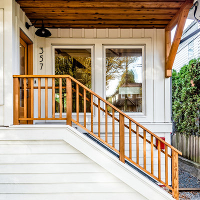 Example of a classic entryway design in Vancouver with a glass front door