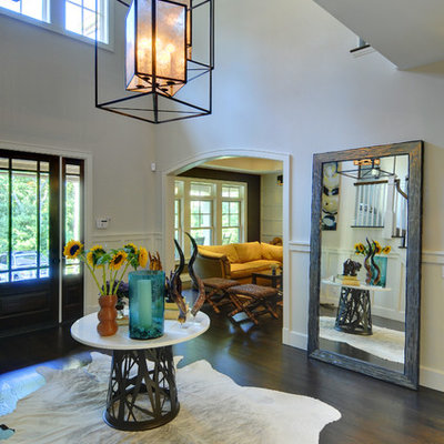 Large trendy dark wood floor entryway photo in New York with gray walls and a glass front door