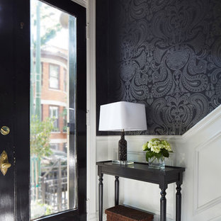 Idee per un ingresso chic con pareti nere, una porta singola, una porta in vetro e pavimento multicolore