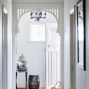 Photo of a beach style entryway in Melbourne with grey walls and dark hardwood floors.