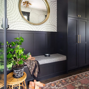 Photo of a bohemian boot room in Seattle with black walls and dark hardwood flooring.